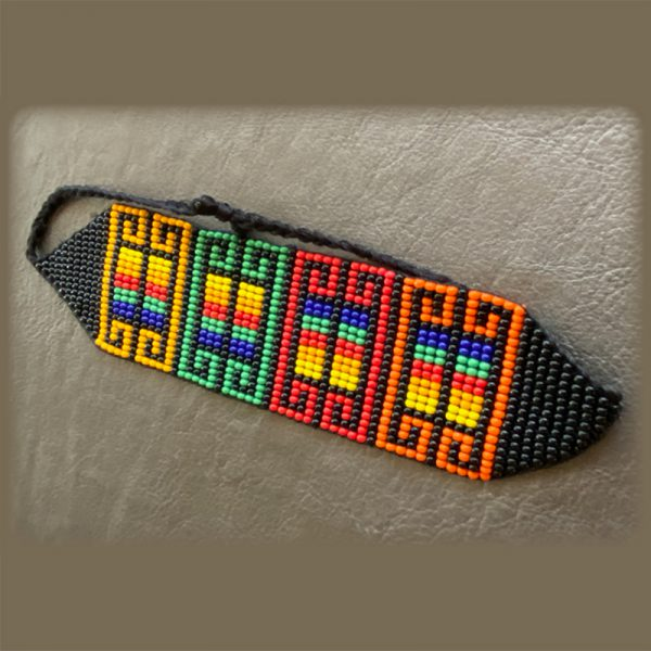 Colorful Beaded Bracelet With Patterns Of Orange, Red, Green, And Yellow
